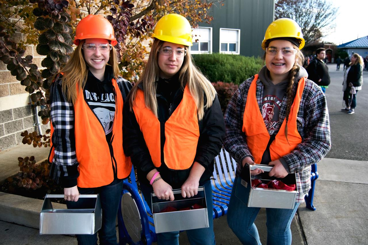 Three high school girls at Pierce County Career Day who participated in Tomboy Tool's girls-only event.